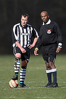 A Delta player and the match referee wait for the kick-off of a Hackney & Leyton Sunday League match at Hackney Marshes - 08/03/09 - MANDATORY CREDIT: Gavin Ellis/TGSPHOTO - Self billing applies where appropriate - Tel: 0845 094 6026