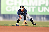 Charleston RiverDogs shortstop Ricky Surum (4) reacts to the ball during a game against the Asheville Tourists at McCormick Field on May 22, 2019 in Asheville, North Carolina. The Tourists defeated the RiverDogs 10-8. (Tony Farlow/Four Seam Images)
