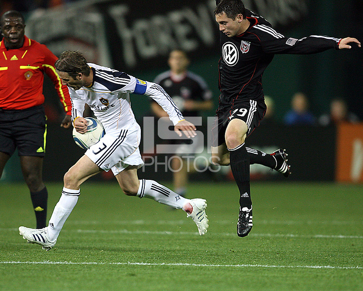 Blake Brettechneider (29) of D.C. United comes up behind David Beckham (23) of the Los Angeles Galaxy during an MLS match at RFK Stadium, on April 9 2011, in Washington D.C.The game ended in a 1-1 tie.