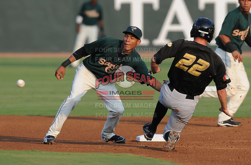Infielder Luis Nieves (7) of the Savannah Sand Gnats drops the ball while attempting to tag Daniel Grovatt (22) stealing second in a game against the West Virginia Power on July 21, 2011, at Grayson Stadium in Savannah, Georgia. (Tom Priddy/Four Seam Images)