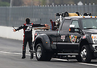 Feb 9, 2014; Pomona, CA, USA; NHRA funny car driver Cruz Pedregon reacts after having a blower explosion during the Winternationals at Auto Club Raceway at Pomona. Mandatory Credit: Mark J. Rebilas-