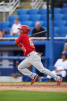 Palm Beach Cardinals shortstop Robelys Reyes (15) at bat during the first game of a doubleheader against the Dunedin Blue Jays on July 31, 2015 at Florida Auto Exchange Stadium in Dunedin, Florida.  Dunedin defeated Palm Beach 7-0.  (Mike Janes/Four Seam Images)