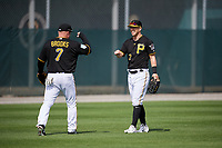 Pittsburgh Pirates Garth Brooks (7) fist bumps Corey Dickerson (12) during the teams first Spring Training practice on February 18, 2019 at Pirate City in Bradenton, Florida.  (Mike Janes/Four Seam Images)