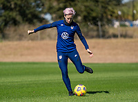ORLANDO, FL - JANUARY 20: Megan Rapinoe #15 of the USWNT crosses the ball during a training session at the practice fields on January 20, 2021 in Orlando, Florida.