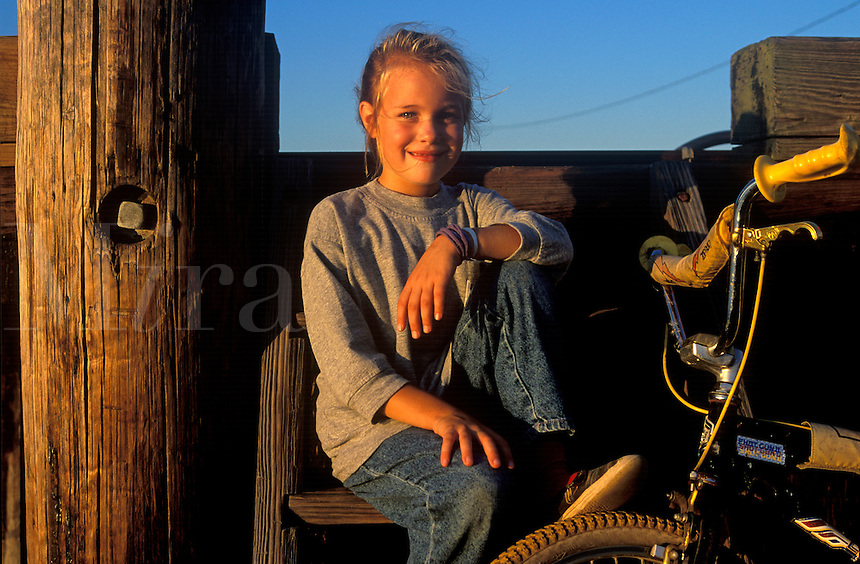 Portrait of a young girl with her bike.