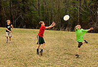 Troop 10 Boy Scouts play a game of frisbee during a spring backpacking in the South Mountains State Park in Connelly Springs, North Carolina.