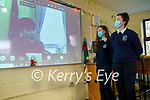 Presentation Secondary School students Katie Dowling and Caragh McGillicuddy watching the Zoom broadcast of Minister Norma Foley (Minister for Education) from Dail Eireann to the school on Friday morning.