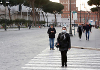 A woman wearing a mask to protect herself from the Covid-19 walks along the Fori Imperiali boulevard in Rome, Italy, March 10, 2020. <br /> UPDATE IMAGES PRESS/Riccardo De Luca