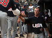 Nolan Fontana is welcomed back into the dugout by Mark Appel after scoring a run in Game 3 of the annual Collegiate Friendship Series between Team USA and Japan on Tuesday, July 5, 2011. Photo by Al Drago.