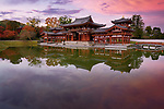 Peaceful autumn scenery of the Phoenix Hall, Amida hall of Byodoin temple on Kojima island of Jodoshiki teien, Pure Land garden pond. Uji, Kyoto Prefecture, Japan 2017 Image © MaximImages, License at https://www.maximimages.com