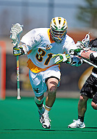 3 April 2010: University of Vermont Catamounts' Face Off Tom Frasca, a Sophomore from Medfield, MA, in action against the Binghamton University Bearcats at Moulton Winder Field in Burlington, Vermont. The Catamounts defeated the visiting Bearcats 11-8 in Vermont's opening home game of the 2010 season. Mandatory Credit: Ed Wolfstein Photo