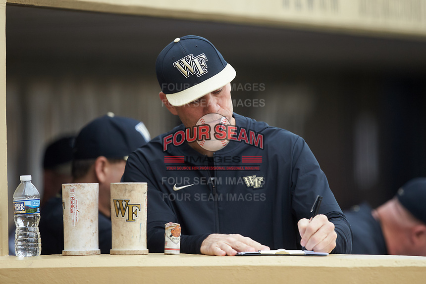 Wake Forest Demon Deacons head coach Tom Walter (16) updates his lineup card during the game against the Sacred Heart Pioneers at David F. Couch Ballpark on February 15, 2019 in  Winston-Salem, North Carolina.  The Demon Deacons defeated the Pioneers 14-1.  (Brian Westerholt/Four Seam Images)