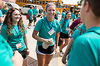 """Katy Spencer, center, socializes with fellow members during """"Circle the City with Service,"""" the Kiwanis Circle K International's 2015 Large Scale Service Project, on Wednesday, June 24, 2015, in Indianapolis. (Photo by James Brosher)"""
