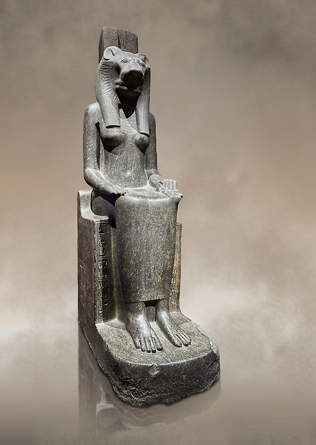 """Ancient Egyptian statue of goddess Sekhmet, grandodiorite, New Kingdom, 18th & 20thDynasty (1390-1150 BC), Thebes. Egyptian Museum, Turin. Grey Background.<br /> <br /> Sekhmet, """"the Powerful One"""" was a fearsome goddess symbolised by her lioness head. Daughter of the sun she personifies the disk of the world during the day. Sekhmet is the angry manifestation of Hathor inflicting the scourges of summer heat, famine and illness which is why the goddess needed to be exorcised every day. Drovetti Collection. C 249"""