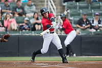 Mitch Roman (10) of the Kannapolis Intimidators makes contact with the baseball during the game against the Hickory Crawdads at Kannapolis Intimidators Stadium on May 21, 2017 in Kannapolis, North Carolina.  The Intimidators defeated the Crawdads 9-8.  (Brian Westerholt/Four Seam Images)