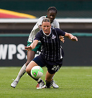 Tina Ellertson, Abby Wambach. The Washington Freedom defeated the Saint Louis Athletica, 3-1.