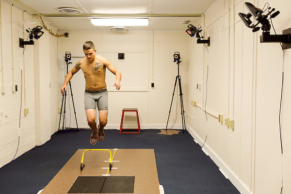 October 21, 2014. Camp LeJeune, North Carolina.<br />  LCpl. John Wood, age 21, participates in a jump and balance test conducted by the University of Pittsburgh. The cameras in the room will create a 3D model of the Marines movements. UPITT is in charge of the medical testing section of the GCEITF.<br />  The Ground Combat Element Integrated Task Force is a battalion level unit created in an effort to assess Marines in a series of physical and medical tests to establish baseline standards as the Corps analyze the best way to possibly integrate female Marines into combat arms occupational specialities, such as infantry personnel, for which they were previously not eligible. The unit will be comprised of approx. 650 Marines in total, with about 400 of those being volunteers, both male and female. <br />  Jeremy M. Lange for the Wall Street Journal<br /> COED