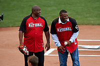 Ken Griffey and Ken Griffey Jr. before throwing out the ceremonial first pitch during the MLB Home Run Derby on July 13, 2015 at Great American Ball Park in Cincinnati, Ohio.  (Mike Janes/Four Seam Images)