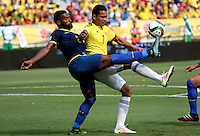 BARRANQUILLA  -COLOMBIA , 28,MARZO-2016. James Rodriguez jugador de Colombia   disputa el balon con Gabriel Achilier de Ecuador    por la fecha 6 de las eliminatorias para el mundial de Rusia 2018 jugado en el estadio Metropolitano Roberto Meléndez./ James Rodriguez of Colombia fights for the ball with Gabriel Achilier of Ecuador  during   a match between Colombia and Ecuador as part of FIFA 2018 World Cup Qualifier six date at Metropolitano Roberto Melendez Stadium on March  28, 2015 in Barranquilla, Colombia. Photo: VizzorImage / Felipe Caicedo / Staff