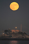 July full moon rising over Alcatrz Island in the San Francisco Bay,