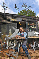 BNPS.co.uk (01202 558833)<br /> Pic: ZacharyCulpin/BNPS<br /> <br /> Pictured: Graham Smith's weather vane's come in all shapes and sizes, he's pictured here with a variety of animal designs<br /> <br /> Something in the wind..<br /> <br /> While Covid caused much of the world to slow down, business has been booming for weathervane maker Graham Smith.<br /> <br /> The former precision engineer has been so busy he has been working seven days a week and has had to close his books to new orders.<br /> <br /> Graham hand-crafts all his weathervanes, creating intricate designs and can even recreate families or significant events.<br /> <br /> With people stuck at home in lockdown and looking at DIY and home improvements, he said he has had his busiest year.