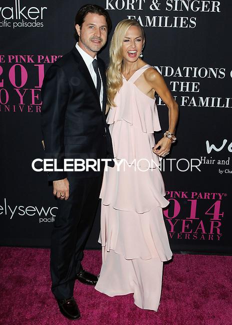 SANTA MONICA, CA, USA - OCTOBER 18: Rodger Berman, Rachel Zoe arrives at Elyse Walker's 10th Annual Pink Party held at Santa Monica Airport HANGAR:8 on October 18, 2014 in Santa Monica, California, United States. (Photo by Celebrity Monitor)