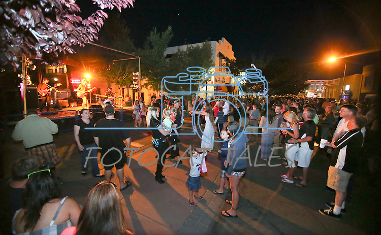 The crowd listens to the Mark Sexton Band in Telegraph Square at the 20th annual Taste of Downtown event in Carson City, Nev., on Saturday, June 15, 2013. The event features 44 local restaurants in a fundraiser for the Advocates to End Domestic Violence.<br /> Photo by Cathleen Allison