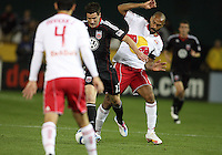 Chris Pontious (13) of D.C. United moves between Rafa Marquez (4) and Tierry Henry (14) of the New York Red Bulls during an MLS match at RFK Stadium, in Washington D.C. on April 21 2011. Red Bulls won 4-0.