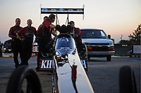 Jul, 8, 2011; Joliet, IL, USA: NHRA top fuel dragster crew members for driver Larry Dixon during qualifying for the Route 66 Nationals at Route 66 Raceway. Mandatory Credit: Mark J. Rebilas-US PRESS