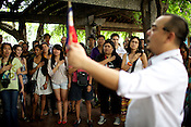 Manila's treasured tour guide, cultural activist, and performing artist, Carlos Celdran seen singing the Filipino national anthem with his tour group in Fort Santiago, Intramuros in Manila, Philippines. Carlos is also considered one of the best travel guides in the world. Photo: Sanjit Das
