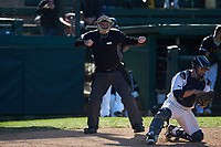 The home plate umpire calls a batter out on strikes during the game between the West Virginia State Yellow Jackets and the Catawba Indians at Newman Park on February 9, 2020 in Salisbury, North Carolina. The Indians defeated the Yellow Jackets 15-9 in game one of a doubleheader.  (Brian Westerholt/Four Seam Images)