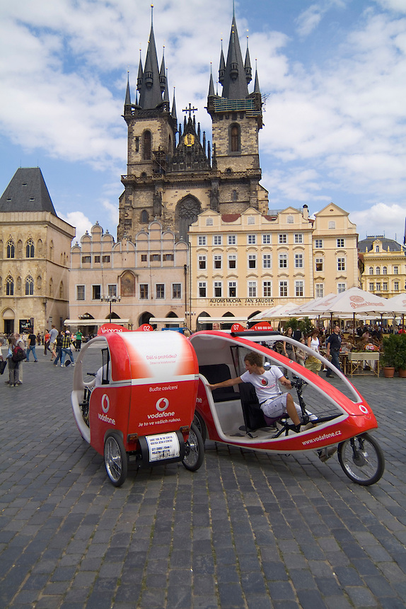 New modern bicycle taxis in the beautiful colorful architecture of Old Town in Prague Czech Republic