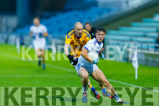 Laune Rangers Eoin Clifford well marked by Spa's Niall<br /> O'Mahony in the Intermediate Football Championship Quarter final.