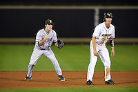 Siena Saints shortstop Rich Gilbride (5) on defense behind base runner Brennan Bozeman (21) leading off second during a game against the UCF Knights on February 17, 2017 at UCF Baseball Complex in Orlando, Florida.  UCF defeated Siena 17-6.  (Mike Janes/Four Seam Images)