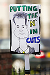 """© Joel Goodman - 07973 332324 . 24/11/2010 . Manchester , UK . Placard featuring a caricature of Lib Dem leader Nick Clegg and the words """" Putting the N in Cuts """". Students and their supporters march and demonstrate through Manchester City Centre against government cuts to student support and rising education fees , specifically against an election pledge made by the Liberal Democrats prior to forming the coalition government . Photo credit : Joel Goodman"""