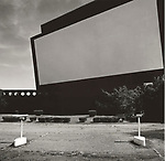 Scan of vintage print. Negative file #79-177-5. 1979. 1 of 1; topographic landscape of drive-in theatre screen.