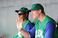 Third baseman Hunter Dozier (13) of the Lexington Legends waves to youth ballplayers parading around the field before a game against the Greenville Drive on Friday, August 18, 2013, at Fluor Field at the West End in Greenville, South Carolina. Dozier was the No. 1 pick (eighth overall) by the Kansas City Royals in the first round of the 2013 First-Year Player Draft. He played collegiate ball for Stephen F. Austin University. Lexington won, 5-0. (Tom Priddy/Four Seam Images)