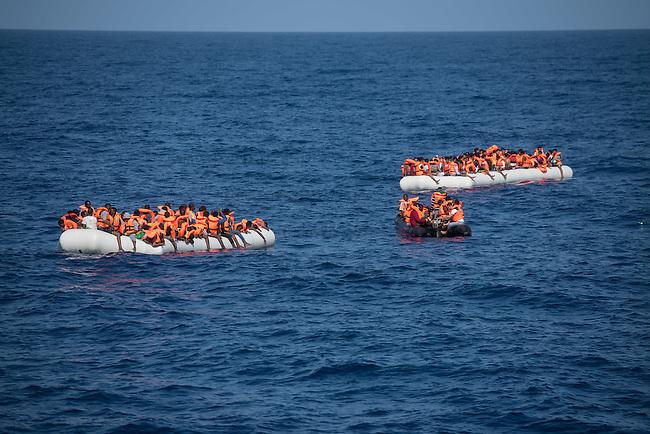 Sea Watch-2.<br /> Die Sea Watch-2 bei ihrer 13. SAR-Mission vor der libyschen Kueste.<br /> Im Bild: Zwei ueberfuellte Schlauchboote mit je ca. 150 und ein Schlauchboot mit ca 15 Gefluechteten. Dei grossen Schlauchboote trieben ueber Stunden orientierungslos herum, denn der Motor wurde ihnen von sog Engine-Fischern abgenommen. Die Crew der Sea Watch-2 versorgte sie ueber mehrere Stunden mit Wasser, bis sie von der italienischen Kuestenwache geborgen werden konnten.<br /> 22.10.2016, Mediterranean Sea<br /> Copyright: Christian-Ditsch.de<br /> [Inhaltsveraendernde Manipulation des Fotos nur nach ausdruecklicher Genehmigung des Fotografen. Vereinbarungen ueber Abtretung von Persoenlichkeitsrechten/Model Release der abgebildeten Person/Personen liegen nicht vor. NO MODEL RELEASE! Nur fuer Redaktionelle Zwecke. Don't publish without copyright Christian-Ditsch.de, Veroeffentlichung nur mit Fotografennennung, sowie gegen Honorar, MwSt. und Beleg. Konto: I N G - D i B a, IBAN DE58500105175400192269, BIC INGDDEFFXXX, Kontakt: post@christian-ditsch.de<br /> Bei der Bearbeitung der Dateiinformationen darf die Urheberkennzeichnung in den EXIF- und  IPTC-Daten nicht entfernt werden, diese sind in digitalen Medien nach §95c UrhG rechtlich geschuetzt. Der Urhebervermerk wird gemaess §13 UrhG verlangt.]