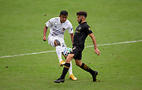 LOS ANGELES, CA - OCTOBER 25: Julian Araujo #22 of the Los Angeles Galaxy and Tristan Blackmon #27 of LAFC get after a ball during a game between Los Angeles Galaxy and Los Angeles FC at Banc of California Stadium on October 25, 2020 in Los Angeles, California.