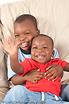 portrait of two brothers at home ages 3 years and 12 months old vertical