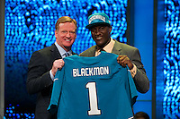 The fifth overall pick wide receiver Justin Blackmon (Oklahoma State) with NFL commissioner Roger Goodell during the first round of the 2012 NFL Draft at Radio City Music Hall in New York, NY, on April 26, 2012.