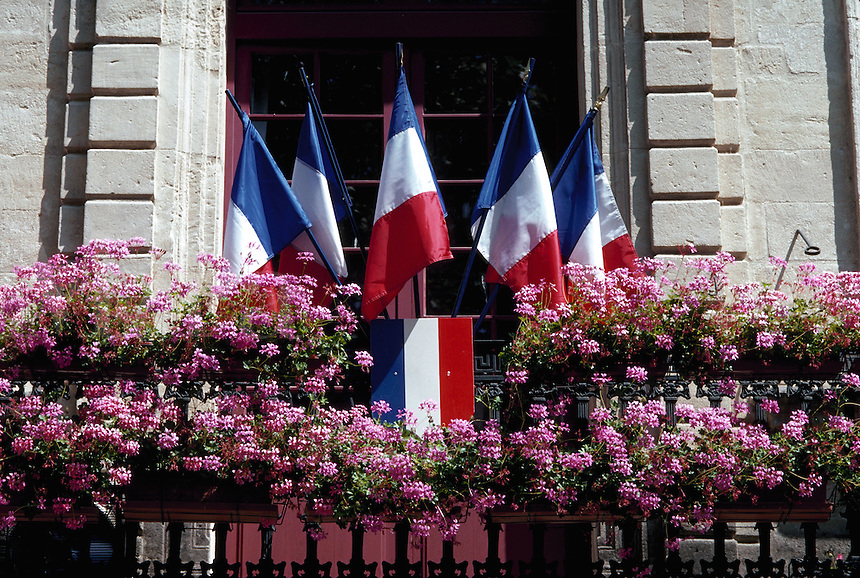 Flags and flowers, Aigues-Mortes, France