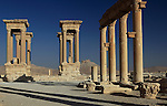 The 16 columns of the Tetrapylon in ancient Palmyra, Syria. Palmyra was an important city of central Syria, located in an oasis 215 km northeast of Damascus and 180 km southwest of the Euphrates river. It had long been a vital caravan city for travelers crossing the Syrian desert and was known as the Bride of the Desert.