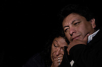 Relatives of the 33 miners trapped inside a tunnel in North of Chile pray during the last moments before the planned rescue of their people.