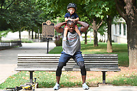 D'Andre Berry of Fayetteville does squats with his son Jaden, 2, Sunday Sept. 13, 2020. Berry cancelled his gym membership at the start of the Covid-19 pandemic and has found other ways to workout and include his son. Berry played football for the Razorbacks under coach Houston Nutt and played in two bowl games. NWA Democrat-Gazette/J.T.WAMPLER)