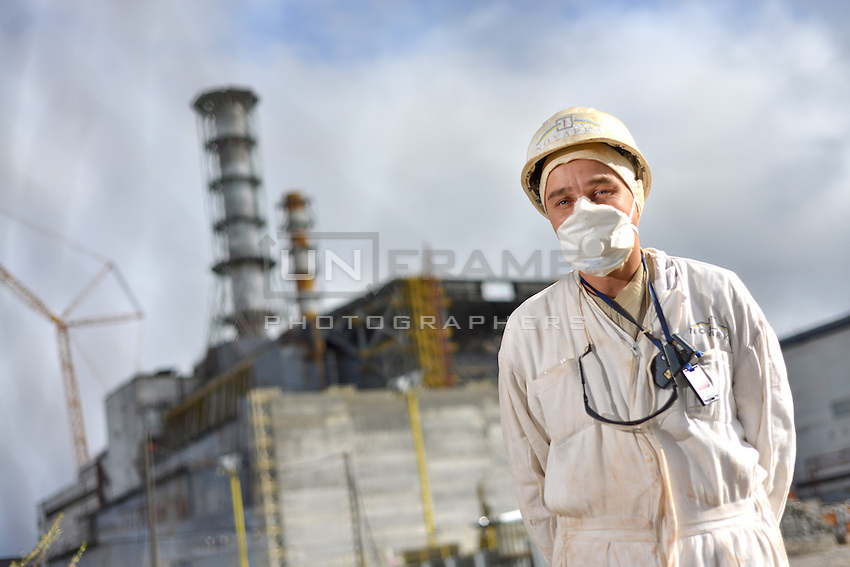 A worker of the restricted area on Chernobyl Nuclear Power Plant seen in front of the sarcophagus incasing reactor no4, which blew up in 1986. By Ukrainian standards workers at CNPP can receive only 2 bars dose per year