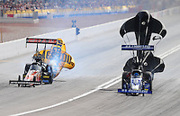 Nov. 2, 2008; Las Vegas, NV, USA: NHRA top fuel dragster driver Larry Dixon (right) defeats Cory McClenathan in the second round of eliminations during the Las Vegas Nationals at The Strip in Las Vegas. Mandatory Credit: Mark J. Rebilas-