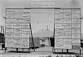 0720-49Elks Exposition entrance displaying signs of the sponsors. Oda Faulconer (1884-1943) is a candidate for Judge of Superior Court. That election was held August 26, 1930. The Elks Exposition was held in July 1929