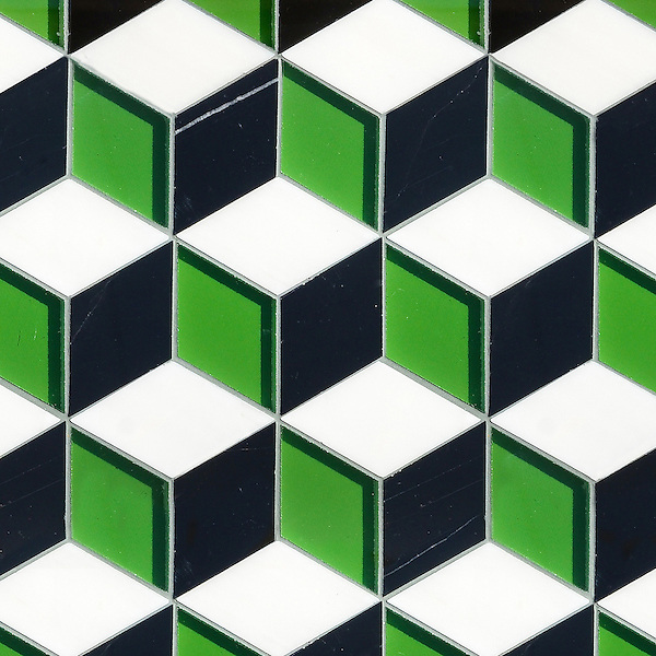 Euclid Grand, a hand-cut mosaic shown in polished Kelley Green glass, Nero Marquina, and Thassos, is part of the Illusions® collection by New Ravenna.