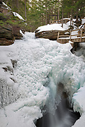 Sabbaday Falls in Waterville Valley, New Hampshire during the winter months. These falls are located on Sabbaday Brook off of the Kancamagus Highway (Route 112) in the White Mountains.